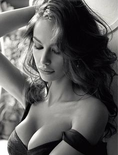 Black and White Photo. Pretty brunette. Visit us at http://www.drgregpark.com/breast-augmentation for breast augmentation and implant information