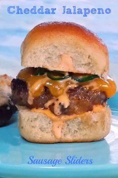 Cheddar Jalapeno Sausage Sliders bursting with flavor, cheese and jalapenos topped with a spicy/sweet siricihi mayo.