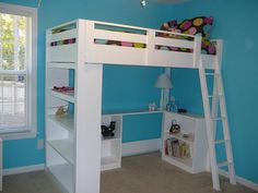 A loft bed with a desk and bookcase
