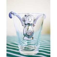 A monkey tea infuser! Like the robot, it comes with a drip tray.
