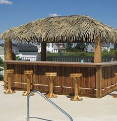 I pinned this here by mistake and came to the board to delete it, but I like it here! lol. DIY Tiki Bar Gallery