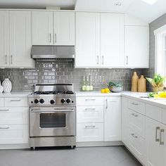 White Kitchen Grey Floor white cabinets, grey glass backsplash and med grey granite. with