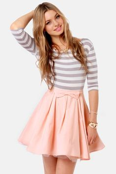 Feminine and so fresh - pale pink skirt and striped marine turtle-neck with plenty of golden accessories.