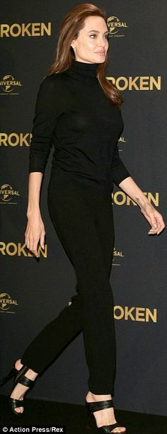 Angelina Jolie steps out in conservative black outfit at photocall for new movie Unbroken | Daily Mail Online
