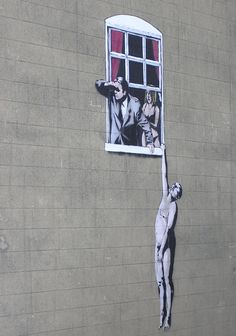 An art work by Banksy, at the bottom of Park Street, in central Bristol, England. The Council have decided not to clean it off.