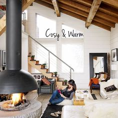 I love everything about this!! (and since i didn't inspect it too closely, by everything I mean the windows, beams, fireplace, open space and paint-ability of the walls)
