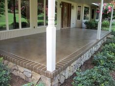 """""""Front or Back Porch Idea..."""" A base of Desert Sand and an overspray of Mocha with a  Mocha border engraved to look like brick. Foundation with a stone finish..."""