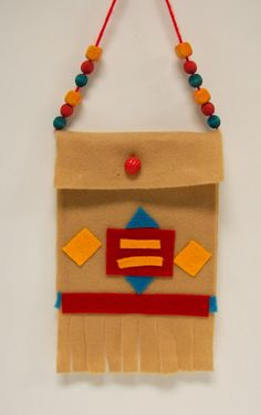 Beaded and quilled Native American charm bags inspired these felt pouches. A x felt piece was cut in two for the front and back pieces. Students planned a symmetrical arrangeme… Native American Projects, Native American History, Native American Indians, Native Americans, American Symbols, Native Indian, Art For Kids, Crafts For Kids, Arts And Crafts