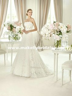 Buy Pronovias Gomera at www.makellybridals.com The Gomera wedding gown is the perfect way to make your wedding distinctive. With its classic looks and ornate lace, you will make an impression on the guests at your wedding.