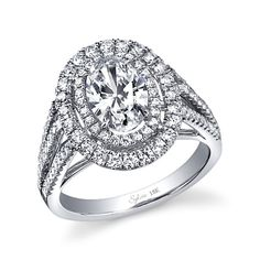 Style# SY383 Designer Double-Halo Triple Shank Diamond Engagement Ring - This stunning designer engagement ring features a dazzling 1.25 carat oval diamond centered in a double halo of shimmering pave diamonds and an elegant triple split shank of cascading diamonds. The total weight of this exquisite ring is 0.96 carats. https://www.sylviecollection.com/designer-double-halo-triple-shank-diamond-engagement-ring-sy383