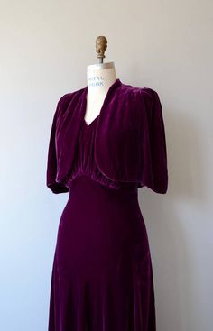 Vintage 1930s plum silk velvet gown, bias cut with gathered bust, deep V back, low row of silk velvet loop buttons at the back and matching elbow sleeve bolero. --- M E A S U R E M E N T S --- fits like: small/medium bust: 30-41 waist: 28 hip: 39 length: 63 brand/maker: n/a condition: