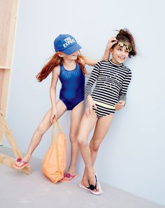 J.Crew girls' baseball cap, one-piece swimsuit in metallic royal, stripe with stars rash guard, stripe tankini set and colorblock floral flip-flops.