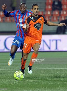 Lorient's French defender Walib Mesloub (R) vies with Caen's French forward Herve Bazile during the French L1 football match Lorient versus Caen on March 14, 2015 at the Moustoir stadium in Lorient, western of France. AFP PHOTO FRED TANNEAU