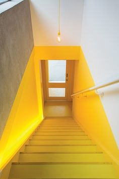 The yellow staircase introduces a sense of ceremony for staff and clients enteri. - The yellow staircase introduces a sense of ceremony for staff and clients entering the new flexible - Yellow Interior, Interior And Exterior, Yellow Stairs, Yellow Hallway, Interior Decorating, Interior Design, Staircase Design, Stairways, Home Deco