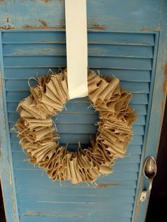 turquoise shutter with spoon handle and burlap wreath