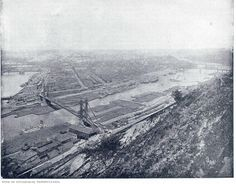 """1900 VIEW OF PITTSBURGH, PENNSYLVANIA. The exact dating of this anonymous photogravure is not known; it is believed to come from an 1890's photo book but the text below the map (""""One hundred and fifty years ago there stood on the delta formed by the Alleghany and Monongahela rivers the old French fort Du Quesne."""") could date it to 1905. The picture was taken from the western edge of Mt. Washington and shows the city in its industrial prime."""