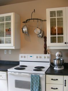 Love this idea with the pans!  Now to just move the microwave!  yeah - right!