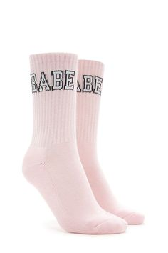 "A pair of knit crew socks featuring a ""Babe"" graphic in all capital letters at the ankle."
