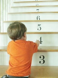 Numbered stairs using semipermanent decals make for a cute look and also an educational tool for young children.