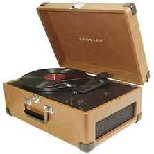 When I was in 5th grade, I received a portable record player for Christmas.  It was similar to this, but looked more like a fabric-covered suitcase.  It was my pride and joy.
