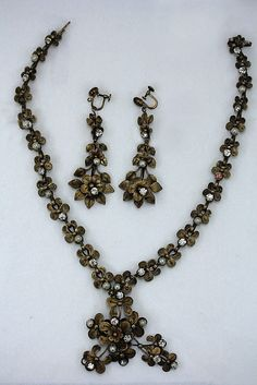 Jewelry set  Date: 1860s Culture: European (probably) Medium: silver, pearl Dimensions: [no dimensions available]  Metropolitan Museum of Art   Accession Number: 1977.289a–c