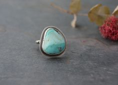 Reserved - Please do not purchase unless this ring is promised to you.  Star stamped and ribbon turquoise ring. Freeform turquoise stone is
