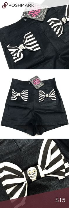 🌟Black Shiny High Waisted Shorts TooFast brand stretchy high waisted shorts with a zipper up the back. The front pockets have black and white striped bows with skull 💀 buttons.  You have to love these 💕  60% Polyester 35% Polyamide 5% Spandex sz 9  Wash cold, dry flat Too Fast Shorts