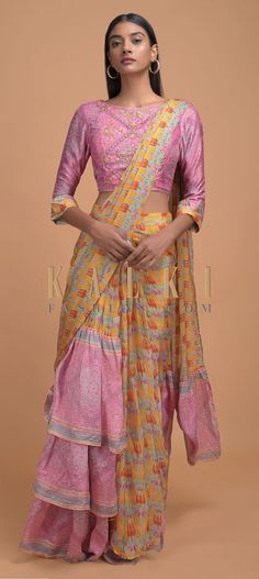 Buy Online from the link below. We ship worldwide (Free Shipping over US$100)  Click Anywhere to Tag Yellow And Pink Ready Pleated Ruffle Saree In Crepe Enhanced With Floral And Paisley Print Online - Kalki Fashion Yellow and pink ready pleated ruffle saree in crepe enhanced with floral and paisley print.Matched with a pink blouse in crepe with paisley print with sequins and thread embroidery.