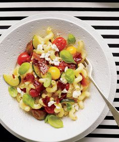 Pasta With Zucchini, Tomatoes, Bacon, and Feta | A weeknight standard in many households, there are endless pasta recipes to choose from. Here are the top 25 as chosen by our Pinterest followers.
