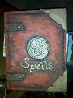 "Spell book How-to - HauntForum. I really like the ""brass"" work Diy Halloween Books, Halloween Witches, Halloween Decorations, Halloween Party, Witch Spell Book, Spell Books, Haunted Props, Haunted Dollhouse, Holiday Fun"
