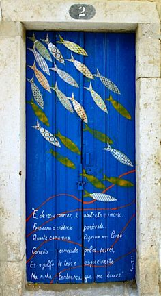 Blue fish door number 2 in Sesimbra, Setúbal, Portugal.