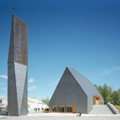 Finnish architects Anssi Lassila and Teemu Hirvilammi of Lassila Hirvilammi with Jani Jansson of Luonti have completed this slate-clad church with a separate steeple in Jyväskylä, Finland.