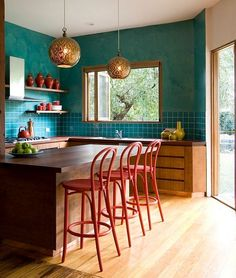 Teal used along with red and gold in the eclectic kitchen