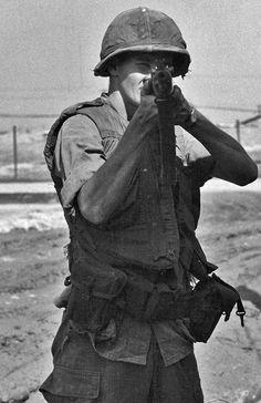 U.S. Marine posing for a photograph. ~ Vietnam War
