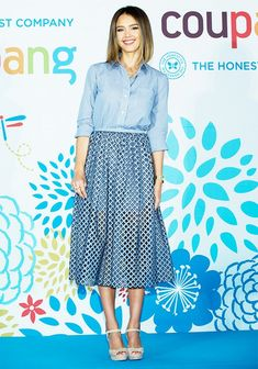 Jessica Alba wears a striped button-town and gingham skirt in Seoul, South Korea.