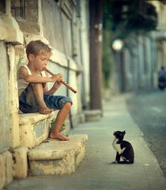 Cool Pictures...a boy playing flute to a kitty that will listen.
