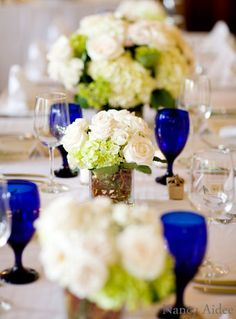 Blooming Gallery - Reception. Add a pop of color with stemware.