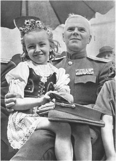 Czech girl with the Red Army general. Prague, May 1945.