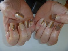Acrylic nails with 2tone Gelish gel polish and gold stripes