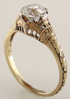 Antique filigree ring with an Old European cut diamond- This distinctive ring is exceptionally well crafted. Note the beauty of the filigree work, the precision of the milgrained edges, and the life-like details of the floral designs.