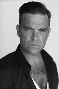 Robbie Williams. Hot, great musician and a fantabulous wit!!!! Oh and hot... Umm and hot.... Super.