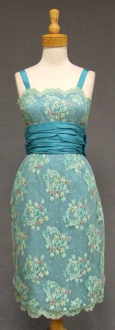 ~A fabulous vintage cocktail dress in aqua lace embroidered with peach, buttercup, cerise and turquoise flowers, each topped with a single se...~