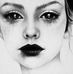 Sadness, Depressed colors of black and white. the way they make the eys look and the how frozen her face looks.