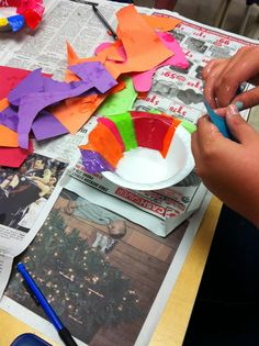 Dip scraps of paper in the art paste and then layeit onto the styrofoam bowls, the next day, once they had dried, the paper forms popped right out of the bowls and the students trimmed the edges