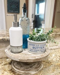 A easy way to dress up your Kitchen sink. add a tiered tray and some decorative bottles for your hand & dish soaps. Then add a pop of greenery. this makes doing dishes a bit more fun! Rustic Kitchen Sinks, Coffee Table Kitchen, Kitchen Sink Caddy, Kitchen Sink Decor, Country Kitchen, Kitchen Stuff, Kitchen Ideas, Highland Homes, Tray Decor