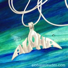 """The Hawaiian greeting of """"ALOHA"""" makes the shape of this sterling silver whale tail pendant by Aloha Latitudes."""