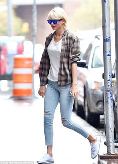 Taylor Swift sports skintight jeans and plaid shirt for casual outing in NYC | Daily Mail Online