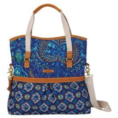 """Printed canvas tote bag with leather embellishments.   Product: ToteConstruction Material: Canvas and leatherColor: IndigoFeatures:  Leather-wrapped haul handles and detachable, adjustable shoulder strapInterior zippered pocket and magnetic closure at topReinforced bottom panel Dimensions: 17"""" H x 17"""" W x 3.25"""" DCleaning and Care: Wipe clean with damp cloth"""