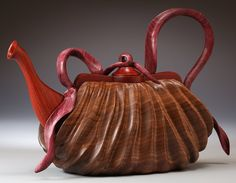 Teapot sculptures carved in wood. Teapot purses and nature wood carvings in teapot forms.  The Art Work Of Denise Nielsen and George Worthington