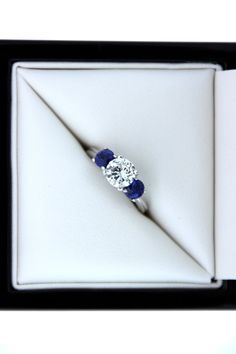 Round Brilliant 1.04ct Diamond and Sapphire Engagement Ring. $6,950.00, via Etsy.